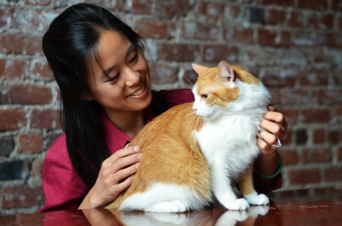 Dr. Yee with Butters. Photo credit: Helen Bae Photography.